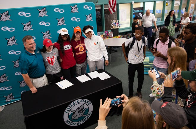 From left: Gulf Coast girls basketball coach Mark Woodruff and players Mya Giusto, Sydney Eugene, Marina Hodo and Yasmeen Chang pose for photos after signing their National Letters of Intent. The Sharks have the talent and chemistry for a deep playoff run.