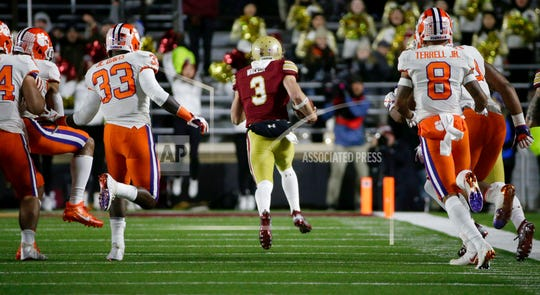 Boston College's Michael Walker (3), a Naples High graduate, runs away from Clemson defenders as he returns a punt for a touchdown against Clemson.