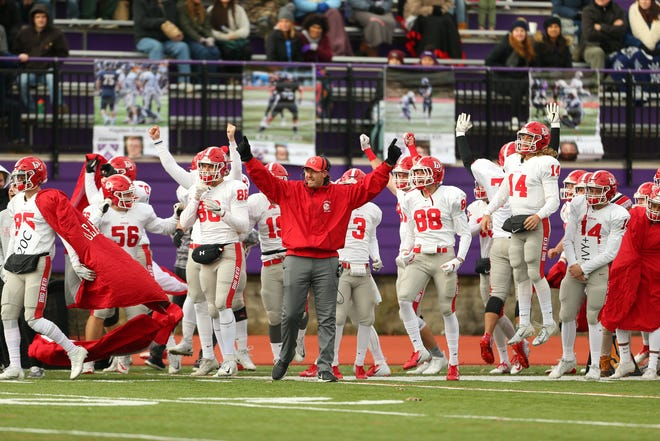 Denison's sidelines, including Utica product Mitch Marston (86) erupts last Saturday after the Big Red won 61-7 at Kenyon. It clinched a share of Denison's first North Coast Athletic Conference title since 1986, and first NCAA Division III playoff berth since 1985.