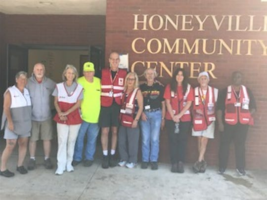 Doug Plunkett, second from the left and former Granville Manager, volunteered at the Red Cross shelter in Wewahitchka, Florida, helping out by distributing food to participating in search and rescue parties.