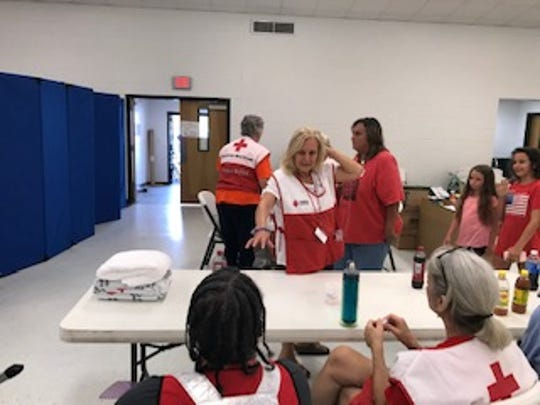 At the shelter, there was 35 other Red Cross Volunteers who helped over 40,000 people who seeked refuge and safety.