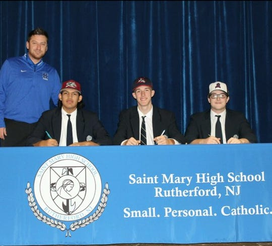St. Mary seniors Kenny Quijano (Rider), Mark Alday (Stony Brook) and Eric Bittiger (FDU) signed their letters of intent to play college baseball on Wednesday.