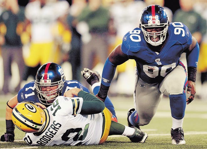 Former Giants defensive end Jason Pierre-Paul celebrates a sack of Packers quarterback Aaron Rodgers in a 2011 regular season game. Pierre-Paul returns Sunday to MetLife Stadium to play the Giants after being traded to Tampa Bay in March.