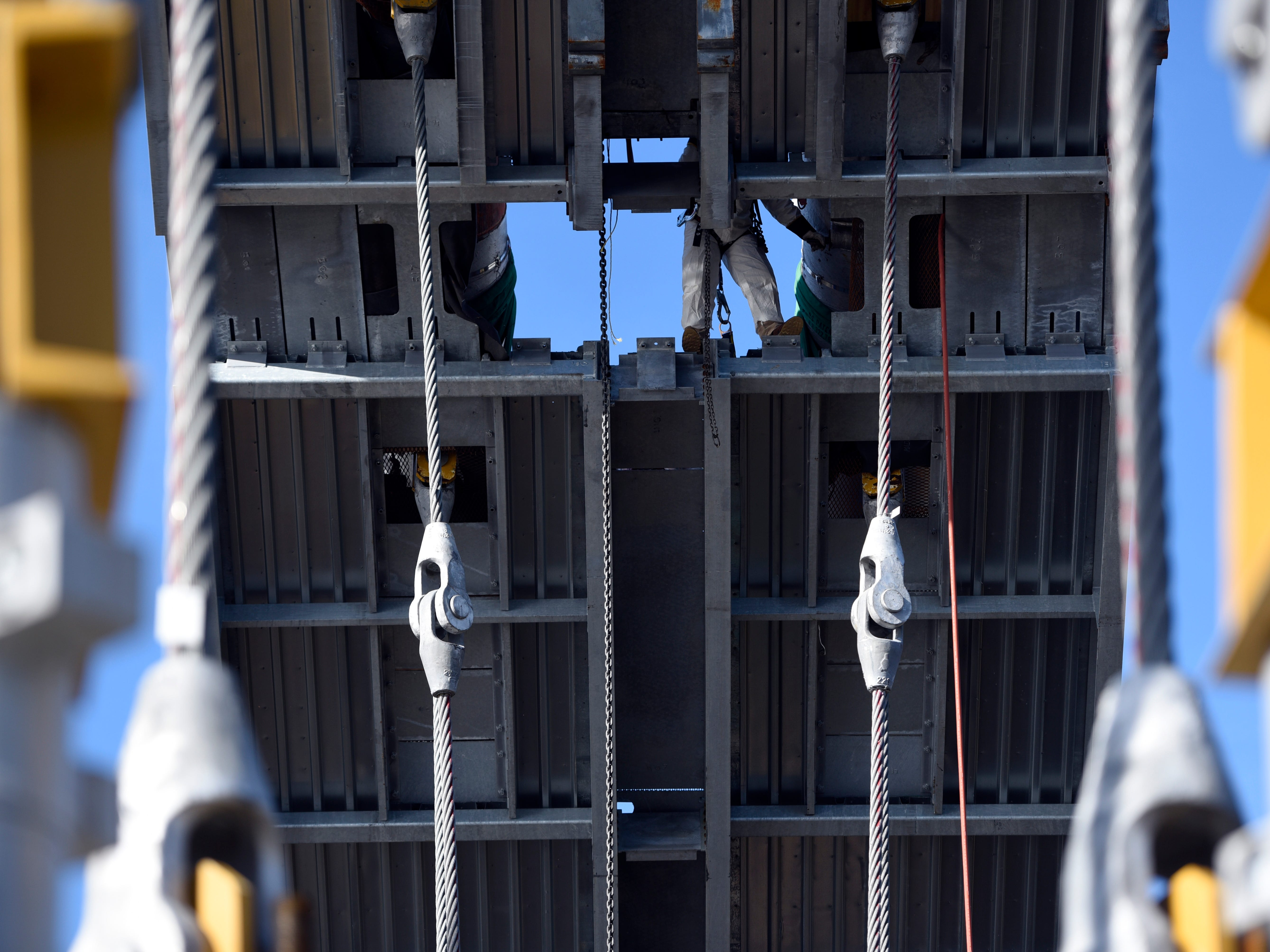 An engineer works on a temporary platform surrounding two of the main cables of the George Washington Bridge on Wednesday, Nov. 14, 2018, in Fort Lee.