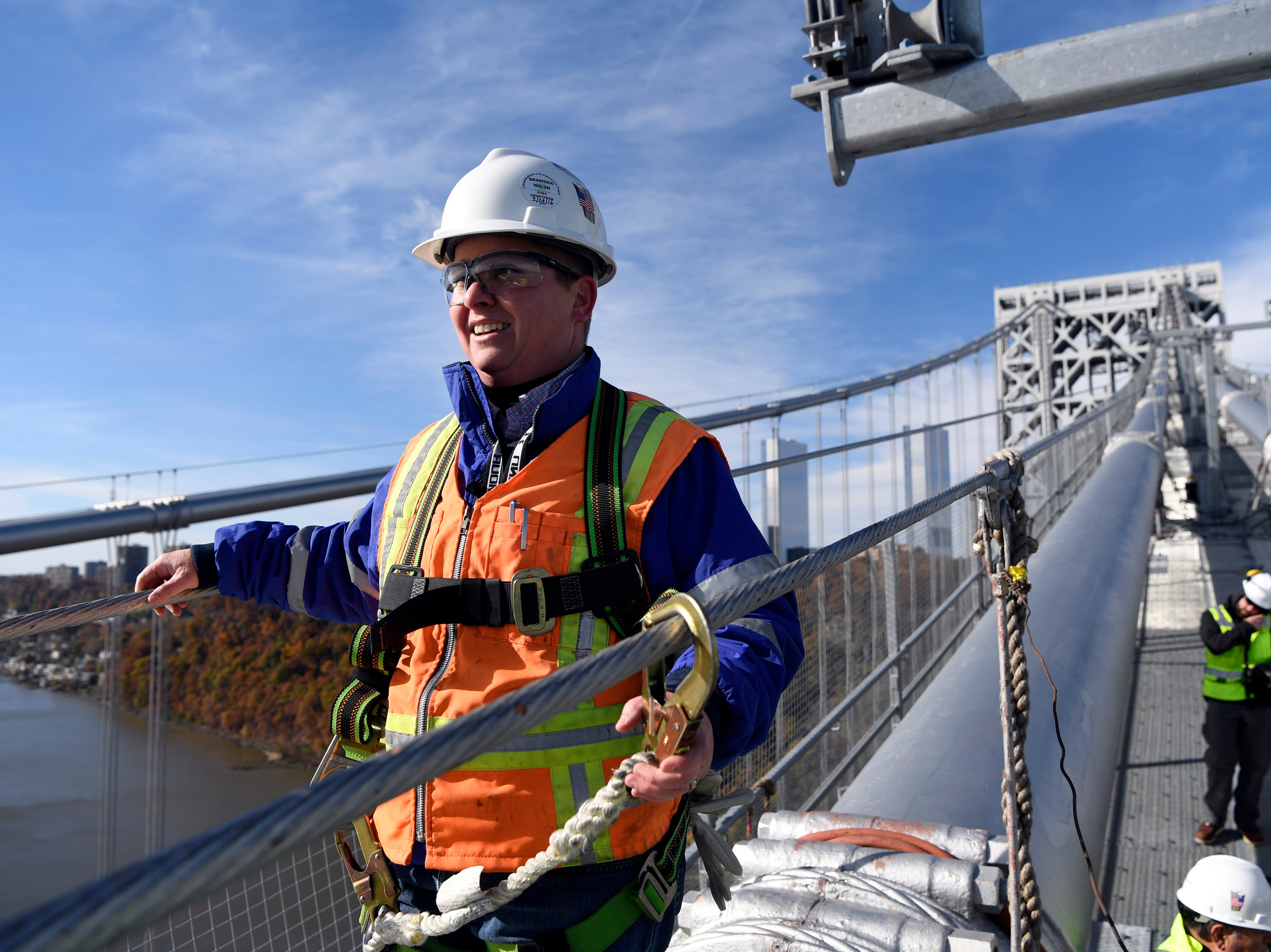 Amanda Rogers, senior engineer of construction, stands on one of the main cables of the George Washington Bridge on Wednesday, Nov. 14, 2018. The Port Authority estimates by 2025 the main cables will be rehabilitated, and all 592 suspender ropes will be replaced. All ropes and cables are original components of the bridge, built in 1927.