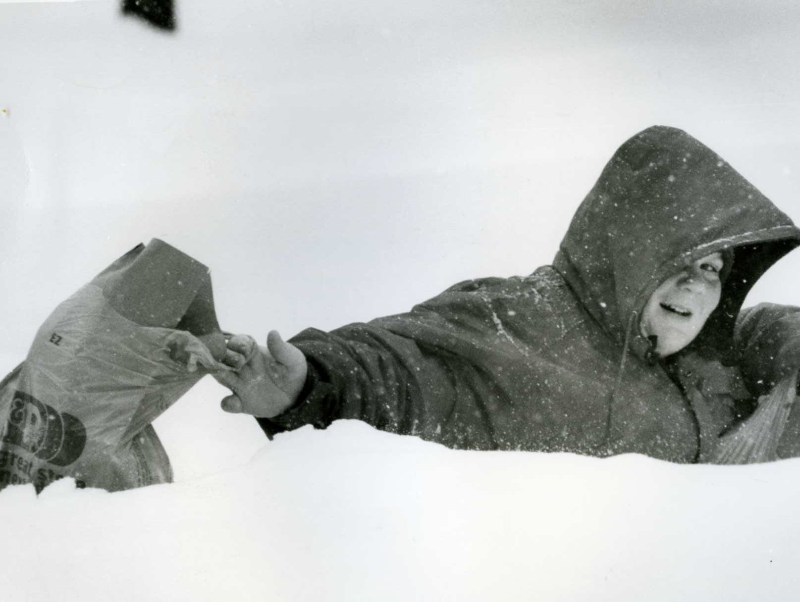 Feb. 11, 1994: Brian O'Donnell, 12, of New Milford, fell into a high drift of snow with shopping bags.