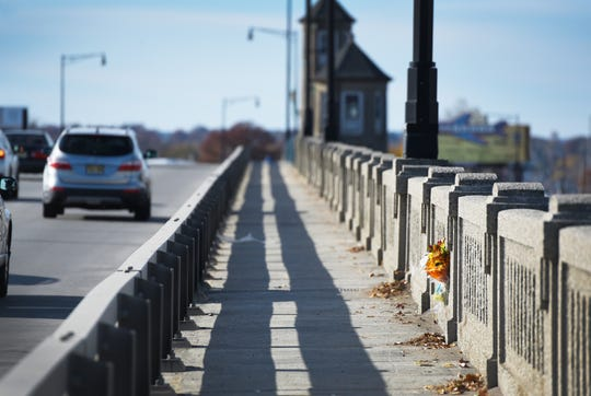 Bouquet of flowers is seen at the spot where his 15 year old Gloria Jean Popp was killed by a hit-and-run driver there in November 1969, photographed on on the Ridgefield Park -Little Ferry Bride on 11/14/18.