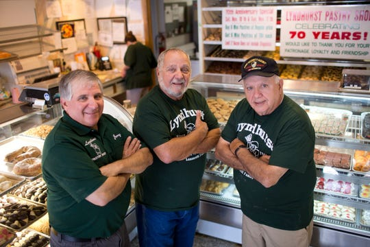 From left: Brothers Jerry Jr., Chuck and Butch Lanzerotti stand in the Lyndhurst Pastry Shop on Saturday, Nov. 10, 2018. The shop celebrated its 70th anniversary Nov. 13. Erica Yoon/Special to NorthJersey.com