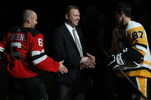 Martin Brodeur shakes hands with Andy Greene of the Devils and Sidney Crosby of the Penguins after the ceremonial puck drop.  Tuesday, November 1, 2018