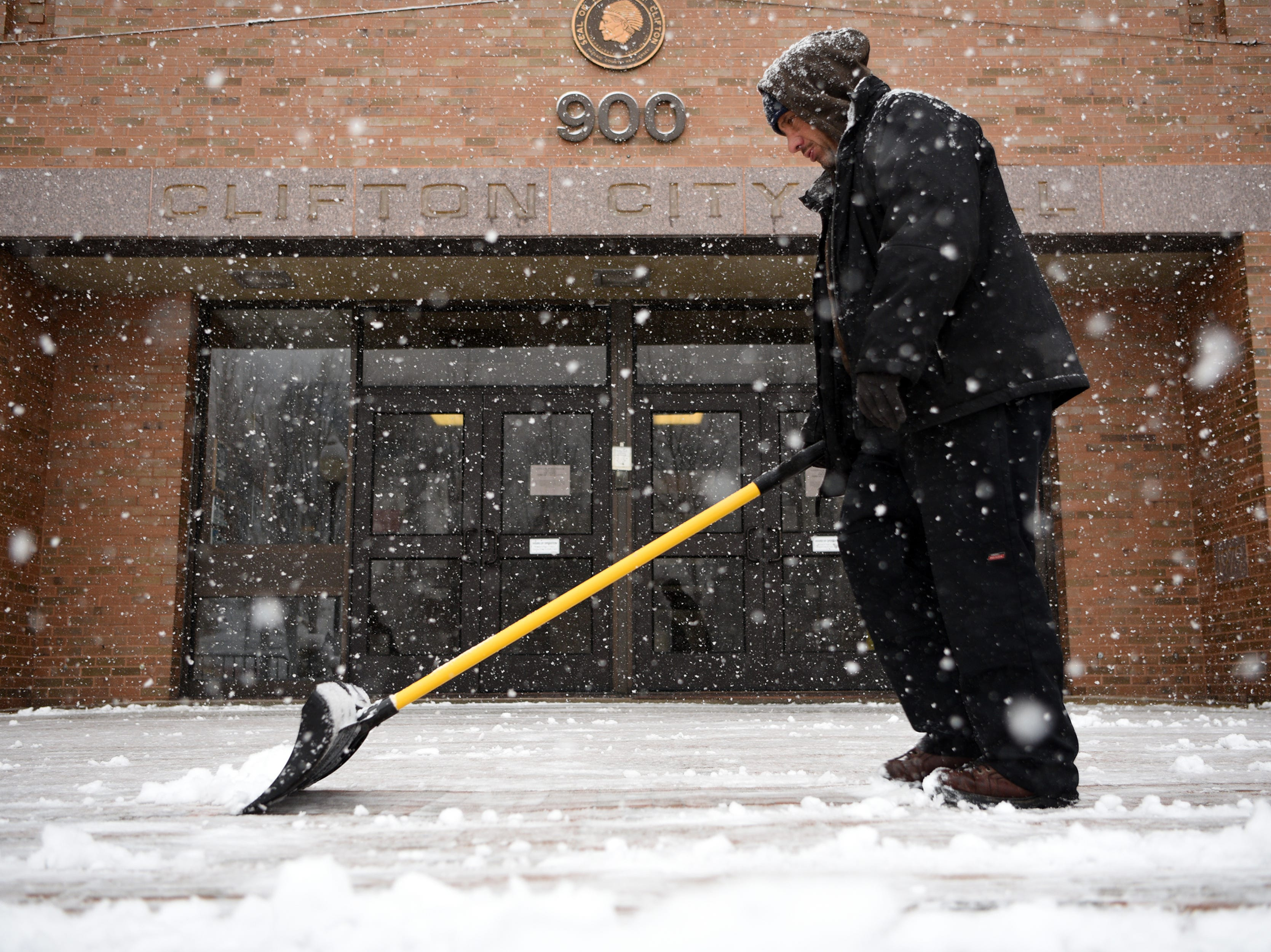 February 9, 2017: The Clifton DPW clears the snow from the entrance to Clifton City Hall during the snow storm.