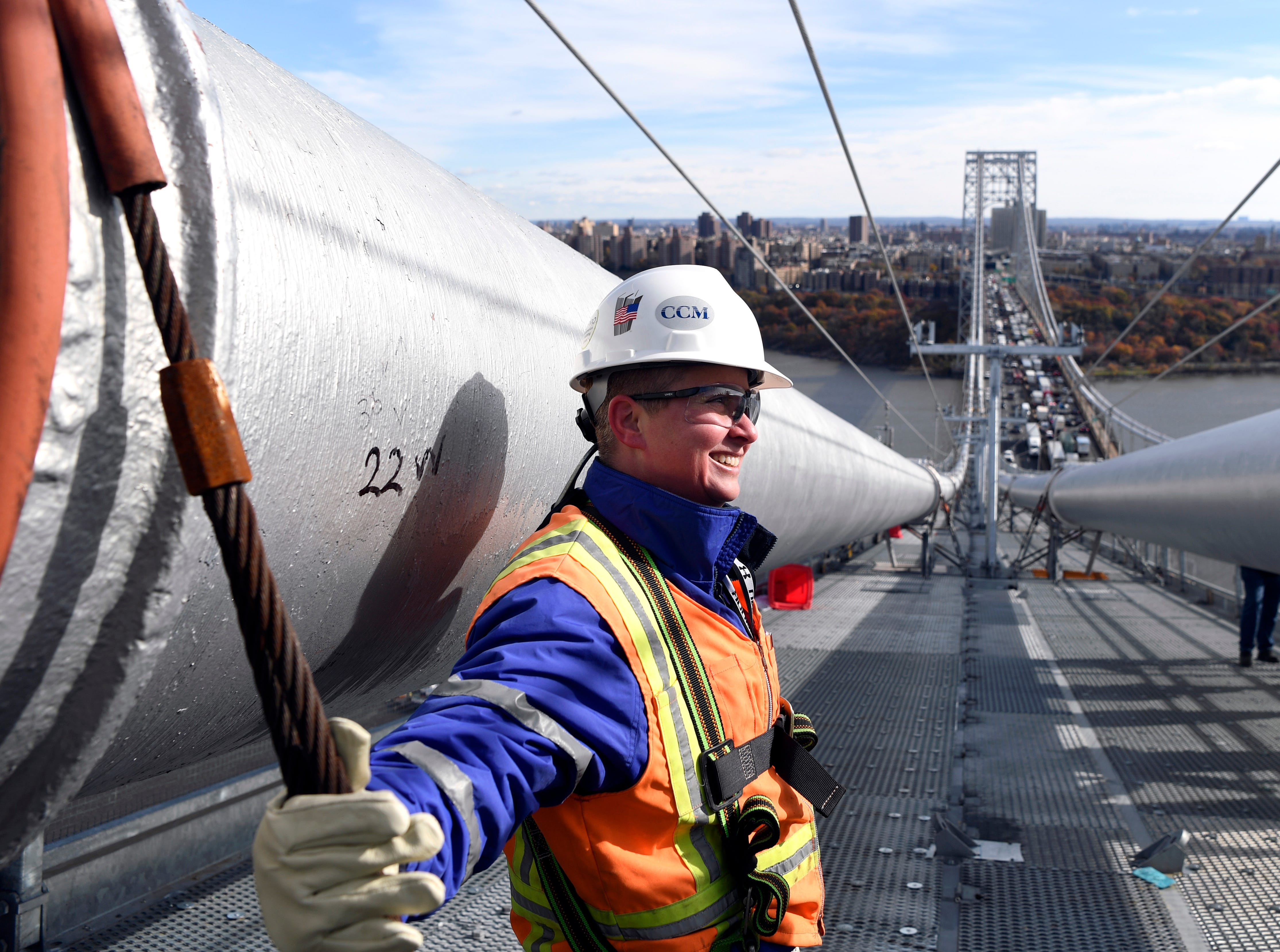 Amanda Rogers, senior engineer of construction, stands on a temporary platform surrounding the main cables of the George Washington Bridge on Wednesday, Nov. 14, 2018.