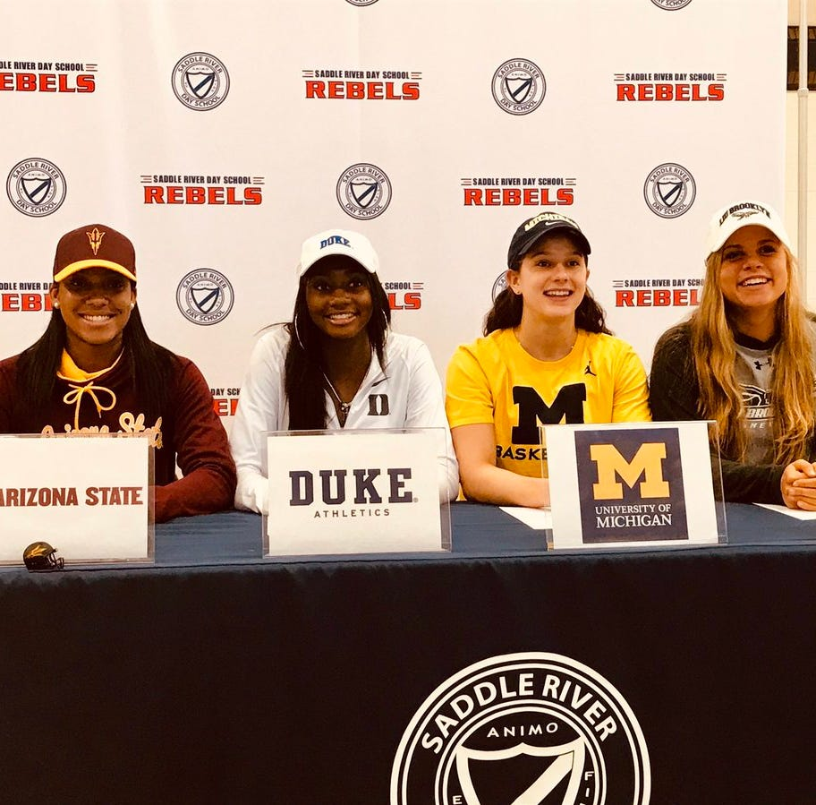Four Saddle River Day girls basketball players signed letters of intent to play Division I basketball on Wednesday. From left to right, Sydnei Caldwell (Arizona State), Jaida Patrick (Duke), Michelle Sidor (Michigan) and Jenna Jordan (LUI Brooklyn)