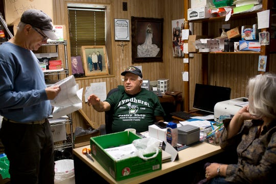 Butch Lanzerotti, 75, sits in his office at Lyndhurst Pastry Shop and talks about his business with his cousin Charlie LaNeve and his wife Becky LaNeve, who were in town for a family wedding visiting from Arizona.   Erica Yoon/Special to NorthJersey.com