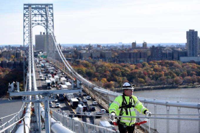 Roger Prince, deputy director of operations and capital delivery, stands on one of the main cables of the George Washington Bridge on Wednesday, Nov. 14, 2018, on the Hudson River.