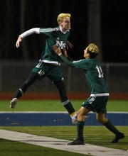 New Providence beat Waldwick 1-0 to win the Group 1 Boys state semifinals held at Indian Hills High School on Tuesday, November 13, 2018. New Providence #10 Devin Mulligan celebrates his game winning goal with teammate #11 Matthew Gonzalez.