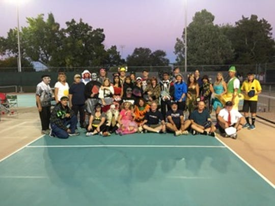 Participants in the Aaron Gifford Pickleball Benefit Round Robin Halloween Party on Oct. 27 at Apodaca Park.