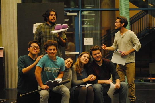 "Pictured are Mozart Pierson, Taylor Rodriguez (Standing), Hugo De Billie, David Johnson, Aliyah Parnell, Emily Rasmussen, Adam Logan (seated) New Mexico State University Theatre Arts Students rehearse a scene from ""Christmas Carol."""