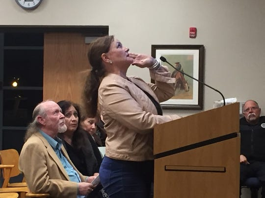 Susan Crenshaw looks at an overhead presentation during the Nov. 13, 2018 Carlsbad City Council meeting.