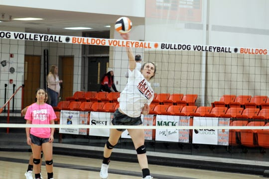 Artesia junior outside hitter Makinli Taylor spikes the ball during Monday's practice in preparation for this week's state tournament. Artesia has the No. 3 ranking in the Class 4A tournament.