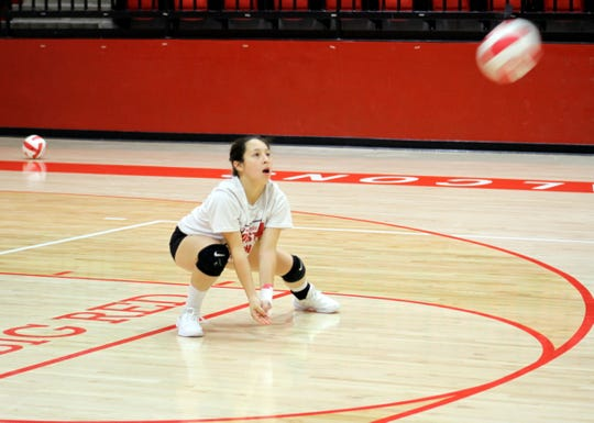 Loving junior defensive specialist Tiana Rodriguez dives for a dig during Tuesday's practice to prepare for this week's state volleyball tournament. Loving is the No. 6 seed in the Class 2A bracket.