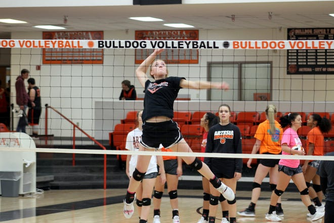 Artesia sophomore middle blocker Presley Skinner loads up for a spike during Monday's practice in preparation for this week's state tournament. Artesia has the No. 3 ranking in the Class 4A tournament.