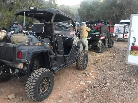 An ATV team with the Mesilla Valley Search and Rescue unloads after a rescue mission in the Gila National Forest Saturday, Nov. 10.