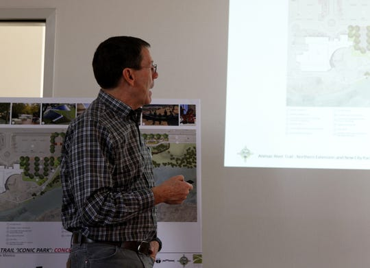 Sites Southwest landscape architect Robert Oberdorfer points to features in a conceptual plan for Gateway Park during a community meeting Wednesday at the Farmington Regional Animal Shelter.