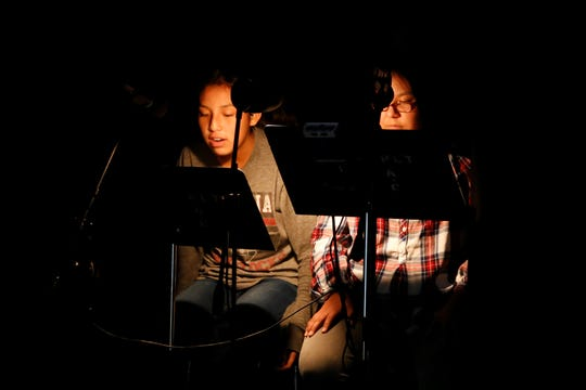 Tsé Bit A'í Middle School students Hana Walter, left, and Autumn Littlehat review their scripts during a rehearsal on Tuesday at the Phil L. Thomas Performing Arts Center in Shiprock.