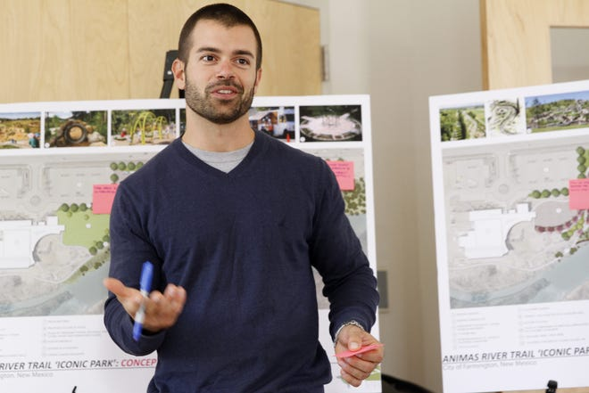 Sits Southwest landscape architect Andrew Bernard discusses plans for a park Wednesday during a community meeting at the Farmington Regional Animal Shelter.