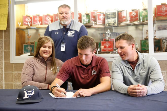 Piedra Vista pitcher Nate Swarts signs his letter of intent on Wednesday to continue his baseball career at New Mexico State University.