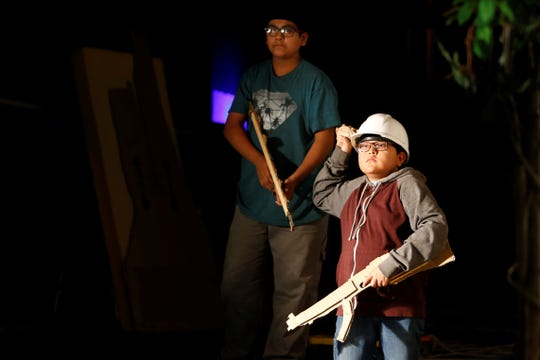 Tsé Bit A'í Middle School students Isaac Ramirez, left, and Talan Benally rehearse their roles as soldiers on Tuesday in a scene that depicts the Navajo Code Talkers at the Phil L. Thomas Performing Arts Center in Shiprock.