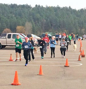 Runners work off some calories at last year's Turkey Trot in Ruidoso.