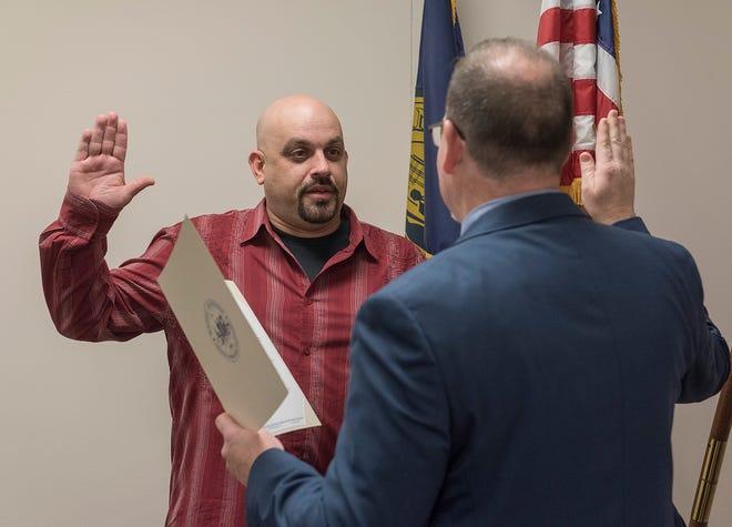 John P. Rhaesa is sworn in as mayor by City Clerk Matt Miller.