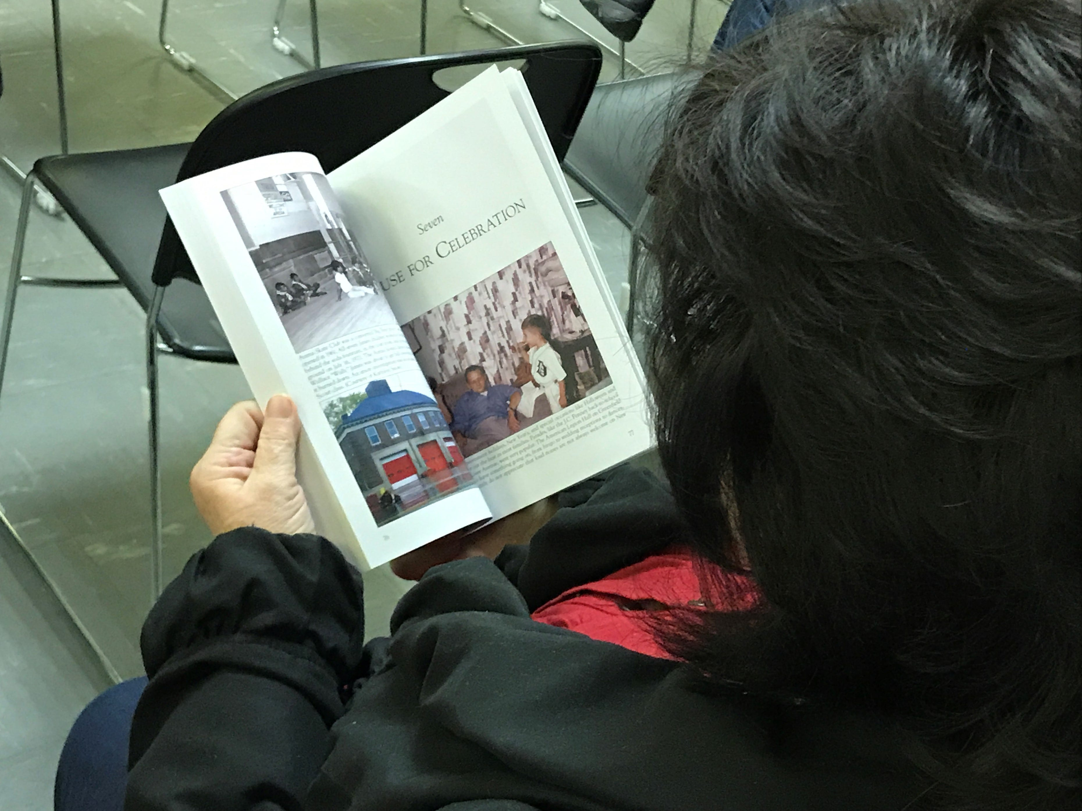 While Joseph McCauley discussed his book, a member of the audience flipped through its pages.