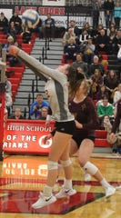 Mercy's junior libero Kayla Shields (2) keeps the ball alive in Tuesday's three-game state quarterfinal sweep over Macomb County foe Stevenson on Tuesday.