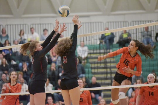 Northville's Laryssa Imbuzeiro (16) goes on the attack against Churchill's Summer Clark (left) and Grace Facione (middle).