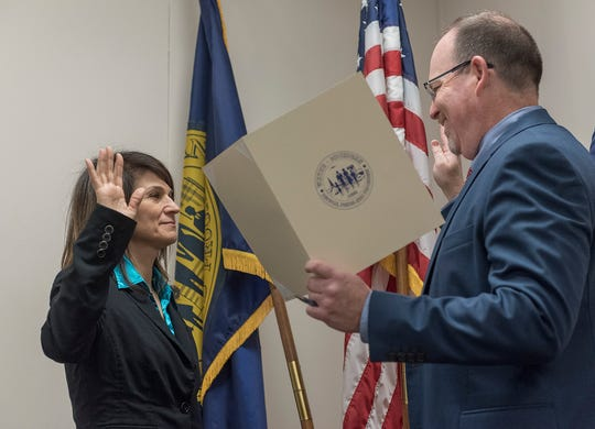 Kelly Skiff answers City Clerk Matt Miller as she is sworn in as a member of council.