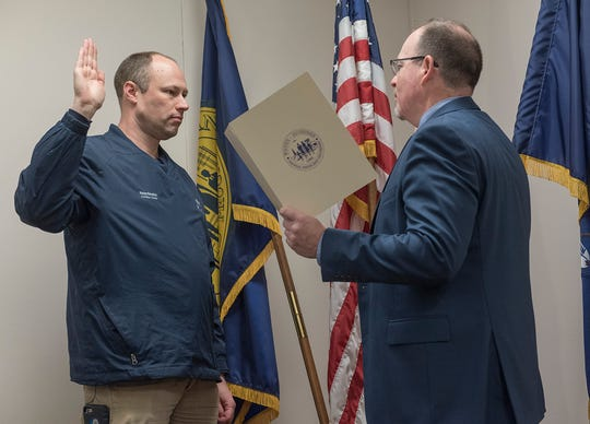 New City Council member Phillip Wagner takes the oath of office, administered by City Clerk Matt Miller.