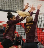 Senior Logan Beyer (7) and sophomore Charli Atiemo (37) go up for a net block for Mercy in Tuesday's quarterfinal victory over Stevenson.