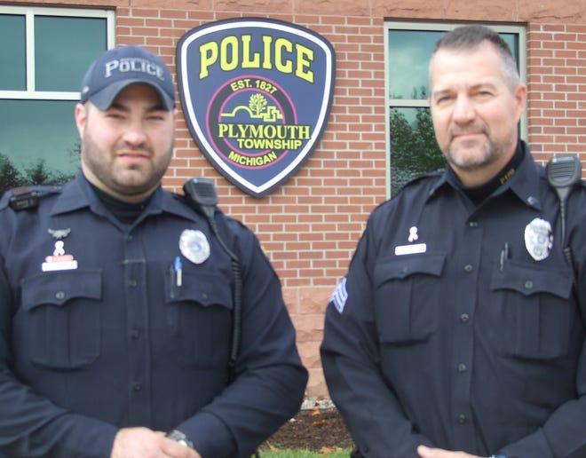 Officer Mike Hinkle, left, and Sgt. Todd Seipenko are among the 27 Plymouth Township officers who are growing beards as a fundraiser for the American Cancer Society and a show of support for a fellow officer who lost his mother to breast cancer.