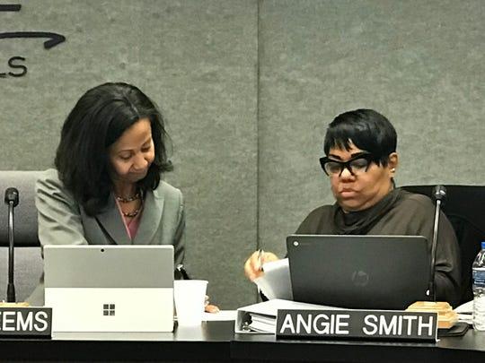 Farmington Board of Education President Terri Weems and Secretary Angie Smith tabulate the votes.
