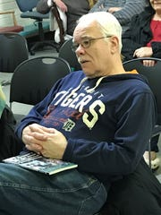Ted Lietz listens to author Joseph McCauley during Tuesday's discussion at the Henry Chaney Library in Detroit.