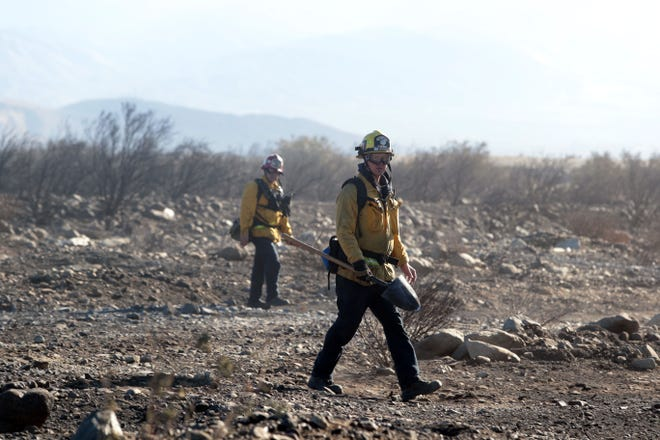 Fire crews work the Sierra Fire as the Santa Ana winds pick up on Wednesday, November 14, 2018.