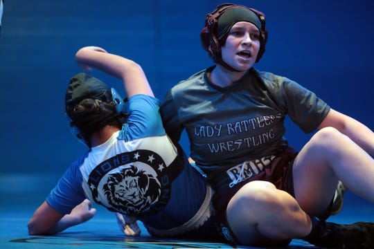 Neveah Bass of Rancho Mirage beats Gizzel Ortiz of Cathedral City during a meet between the Coachella Valley's two largest girls wrestling squad on Tuesday, November 13, 2018 in Cathedral City. The event was held inside the Cathedral High School theater.