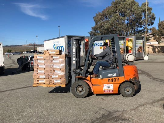 A forklift operator on Wednesday, Nov. 14, 2018, transfers a pallet of frozen turkeys to one of the charitable groups benefiting the donation of 10,000 holiday birds by the Morongo Band of Mission Indians.