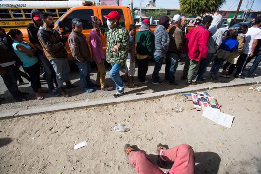 Members of the fist wave of the migrant caravan line-up to receive a meal at the Desayunador Salesiano Padre Chava as they arrive in Tijuana, Mexico on November 13, 2018. The group of 350 migrants traveled in 9 buses on the last part of the trip from Hermosillo, Sonora.