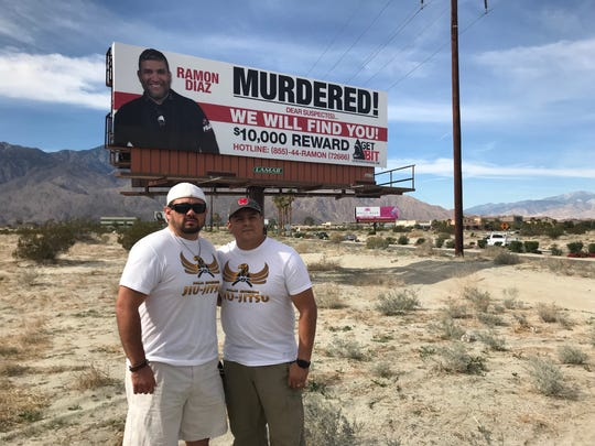 Bradley Alvarez and Juan Caballero, former students of Jiu-Jitsu studio owner Ramon Diaz, attend unveiling of billboard designed to help shine light on the unsolved case.