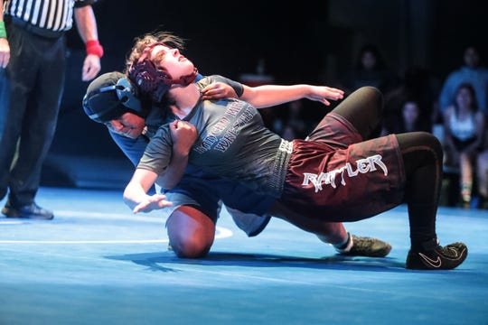 Alondra Gonzalez of Cathedral City beats Alexis Eblin of Rancho Mirage during a meet between the Coachella Valley's two largest girls wrestling squad on Tuesday, November 13, 2018 in Cathedral City. The event was held inside the Cathedral High School theater.