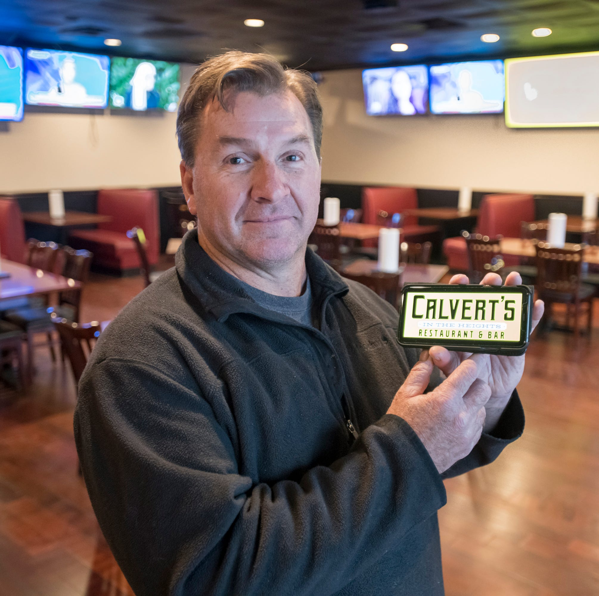 Calvert's in the Heights Restaurant & Bar co-owner and namesake Scott Calvert shows what the sign will look like when they open in a few weeks at the former location of Passage to India restaurant location on East Cervantes in Pensacola.