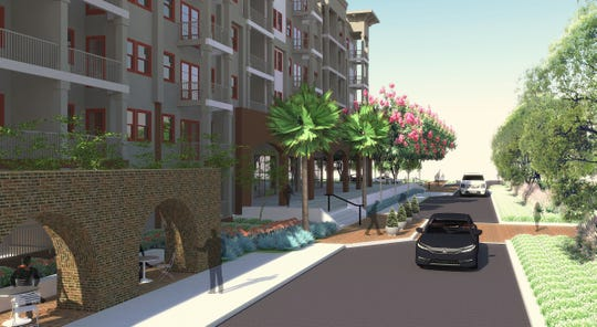 A conceptual image shows what the Two Hundred Garden West development could look like from a view on Spring Street. The preserved arched wall from the USO Building are visible in the left side of the image.